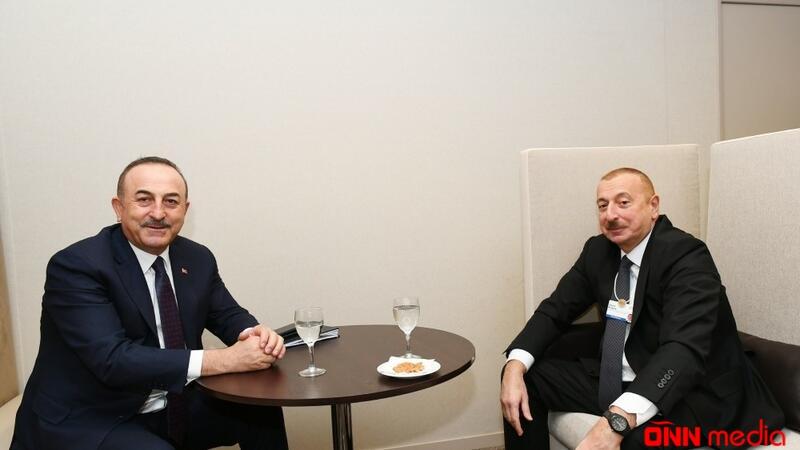 İlham Əliyev Davosda Türkiyənin Xarici İşlər naziri ilə görüşüb